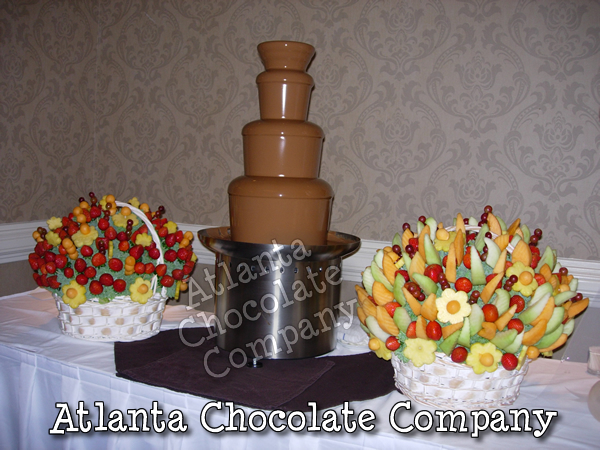 34 INCH CHOCOLATE FOUNTAIN AT WEDDING IN ATLANTA GEORGIA WITH BELGIAN MILK CHOCOLATE ACCOMPANIED BY BEAUTIFUL EDIBLE FRUIT BASKETS