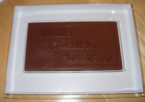 We have special packaging available for presenting your custom chocolate bars to your recipients, these boxes are designed so you can include custom decoration or additional information inside the box.